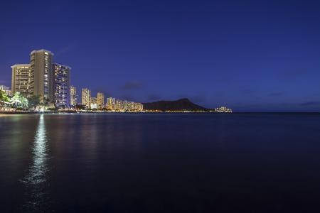 waikiki beach: Waikiki Beach Honolulu Hawaii resort hotels and diamond head peak at night.