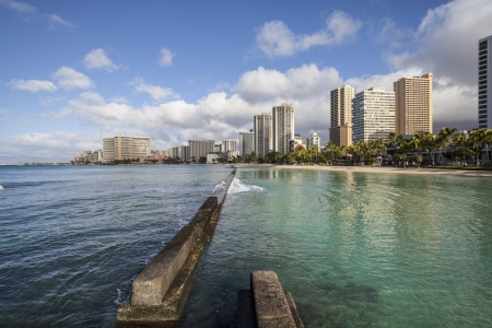 Waikiki beach breakwater in early morning light. photo