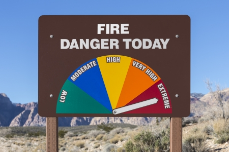 Extreme fire danger today sign with Mojave desert background Stock Photo - 17107698