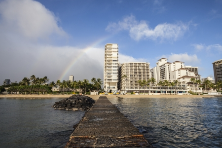 Rainbow above Waikiki high rise towers.