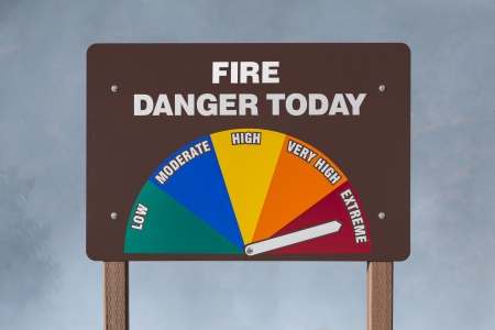 Extreme fire danger today sign with smoke background
