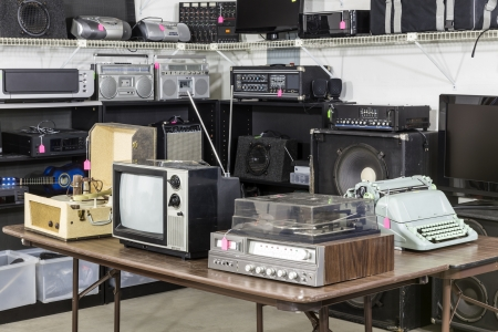 Vintage consumer electronics inside a funky thrift antique store Stock Photo