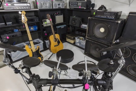thrift box: Interior music store with vintage used equipment.