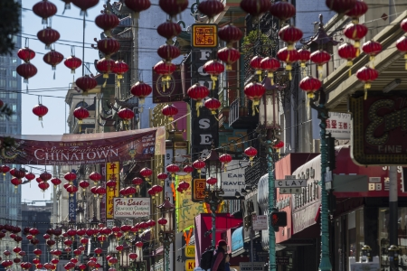 Festive lanterns and signs in San Francisco's Chinatown tourist district. Stock Photo - 17523760