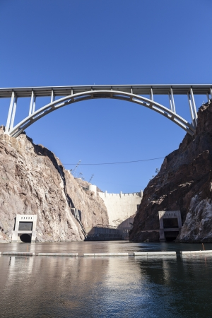 River view of Nevada's historic Hoover Dam and the newly opened bypass bridge. Stock Photo - 17692620