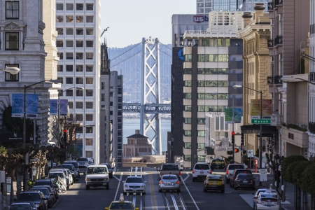 Editorial view of California Street, San Francisco with Bay Bridge background. Stock Photo - 18037009