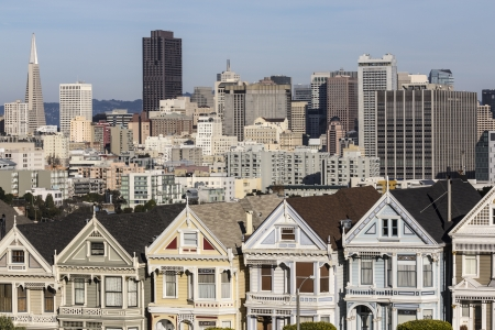 Famous San Francisco victorian homes and skyline.