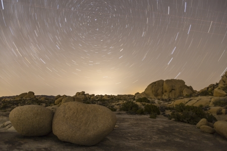 star path: Star lit landscape at Joshua Tree National park in Californias Moave desert. Stock Photo