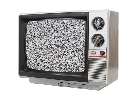 Grungy little television isolated with static screen. Stock Photo