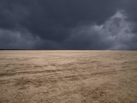 a mirage: Dark storm clouds at El Mirage dry lake in California