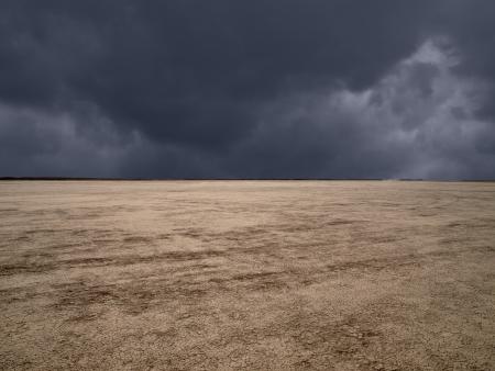 Dark storm clouds at El Mirage dry lake in California