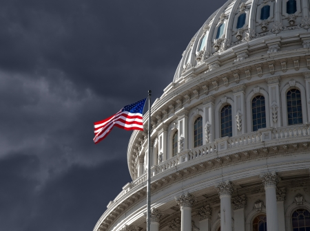 Dark sky over the US Capitol building dome in Washington DC