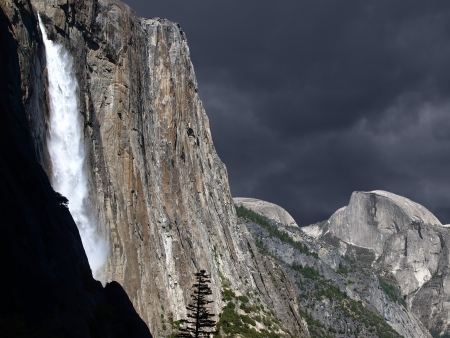 Spring storm cloud and with Yosemite Falls and Half Dome.. Stock Photo - 18435792