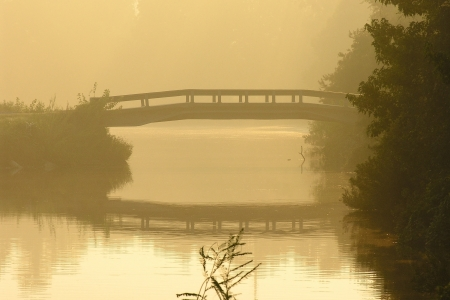 bayou swamp: Misty morning bridge over calm waters in the southeastern United States    Stock Photo
