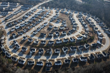 culdesac: Suburban sprawl housing track in late afternoon light. Stock Photo