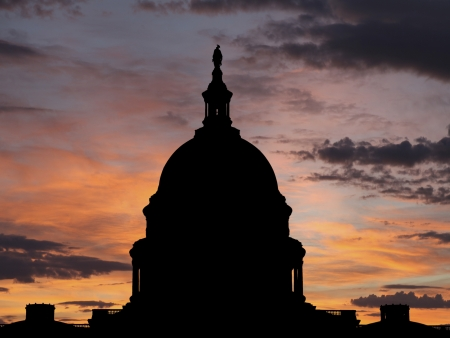 United States Capitol dome silhouette with sunrise sky.. Stock Photo - 18782450