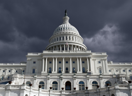 legislative: US Capitol building with dark storm sky in Washington DC.   Stock Photo