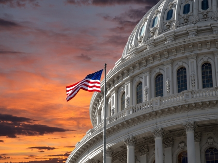 us government: Sunset sky over the US Capitol building dome in Washington DC