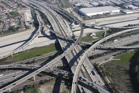 Massive freeway interchange at the 710 Long Beach and the 105 Century Freeway in urban Los Angeles    Stock Photo