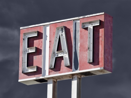 Retro faded eat sign with thunderstorm sky. Stock Photo - 20246165
