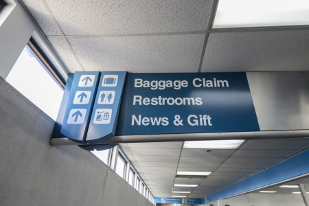 Airport baggage claim signage in regional municipal owned airport.