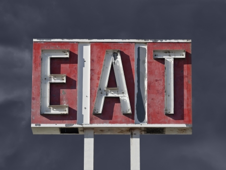 Vintage eat sign ruin with dark thunderstorm sky Stock Photo - 20366249