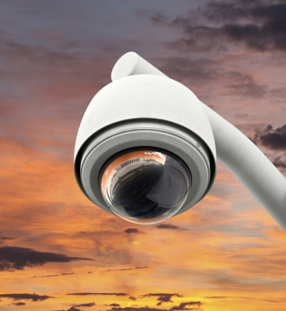 High tech overhead security camera with bright sunset sky Stock Photo - 20366248