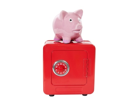Vintage piggy bank on coin bank safe isolated  Stock Photo - 20366274
