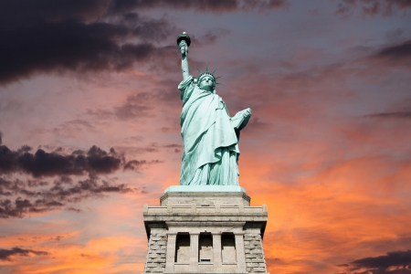 An upshot of the statue of liberty with sunset sky. Stock Photo - 20366826