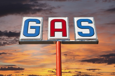 mojave: Old isolated gas sign with desert sunset sky. Stock Photo