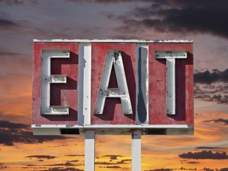 Vintage eat sign ruin with sunset sky. Stock Photo - 20625186