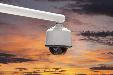 Outdoor security camera isolated with sunset sky. Stock Photo - 20625185