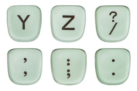 Vintage green Y and Z typewriter keys and punctuation marks macro detail on white. Stock Photo - 20625194