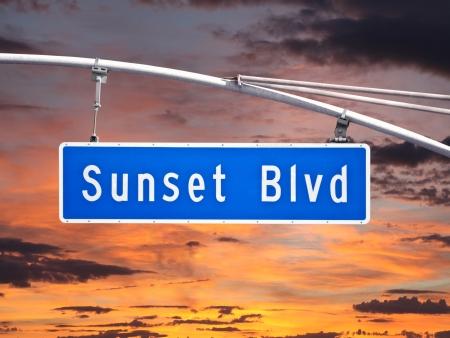 Sunset Blvd overhead street sign with sunset sky. Stock fotó