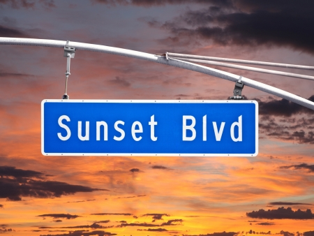 bl: Sunset Blvd overhead street sign with sunset sky. Stock Photo
