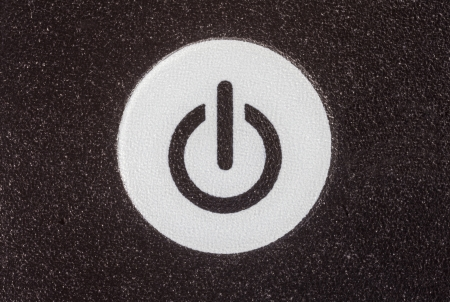 control power: Remote control power button extreme macro detail.