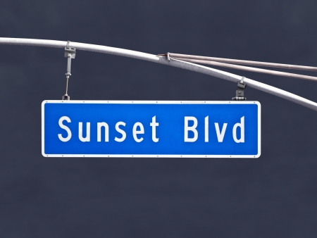 Sunset Blvd overhead street sign with dark storm sky. Stock Photo - 20962586