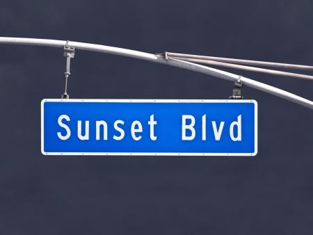 Sunset Blvd overhead street sign with dark storm sky. Stock Photo - 20962586
