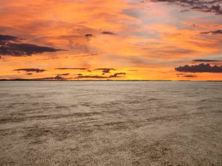 a mirage: El Mirage dry lake with sunset sky in Californias Mojave Desert. Stock Photo