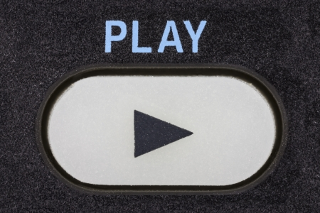 Remote control device play button macro detail.