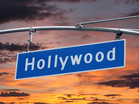 bl: Hollywood Blvd street sign with orange sunset sky