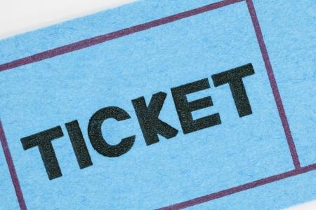 raffle ticket: Blue ticket stub macro detail.