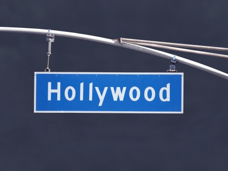 Hollywood Blvd overhead street sign with dark storm sky. Stock Photo - 21580428