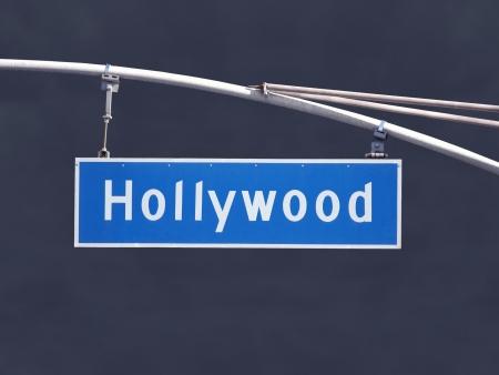hollywood hills: Hollywood Blvd overhead street sign with dark storm sky.