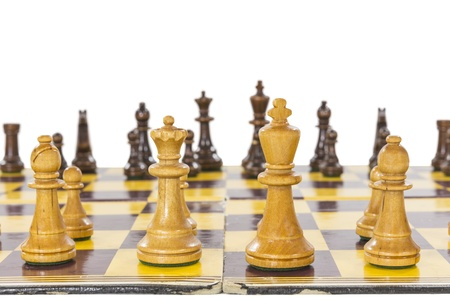 Vintage chess set with worn board close up.   Stock Photo - 21580430