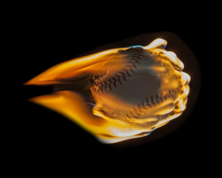 Red hot flaming baseball flying into darkness.   Stock Photo - 21580434