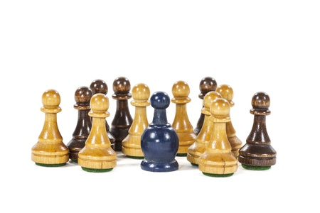 A unique vintage blue pawn symbolizes diversity from the crowd.   Stock Photo - 21580432