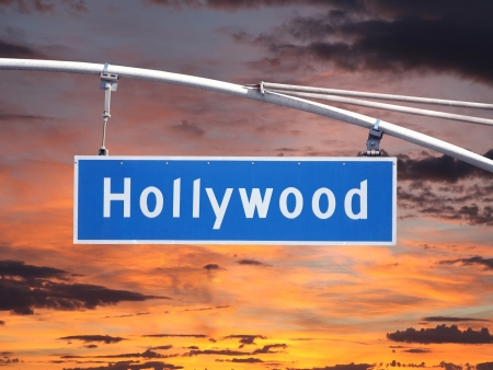 hollywood boulevard: Hollywood Blvd overhead street sign with sunset sky  Stock Photo