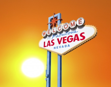desert sun: Welcome to Fabulous Las Vegas sign with setting desert sun  Stock Photo