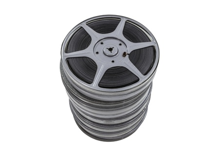 Vintage movie reel and film cans stacked high and isolated. Stock Photo - 21892682